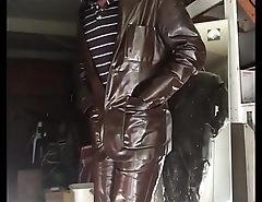 man in shiny brown tight leather pants