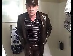 man in tight shiny brown leather suit masturbating 2