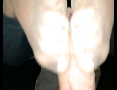 homemade footjob with cumshot in her nylons