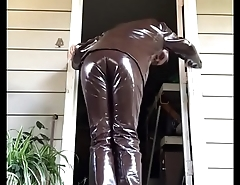 man in a brown leather suit masturbating