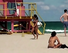 Depraved leaves a girl with her tits out on the beach