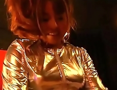 Escort girl in shiny outfit pegging business man